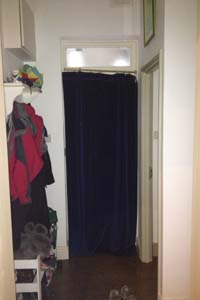 Portiere rod and interlined curtain fitted to Front Door in North London - the door is closed
