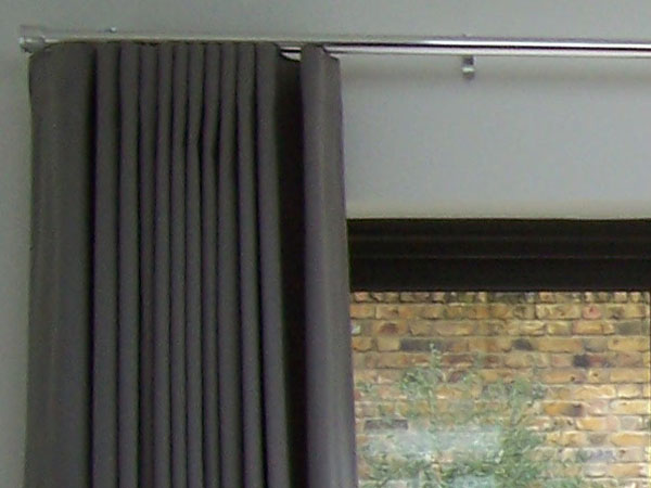 Wave system curtains stacking back neatly on chrome 30mm Silent Gliss Metropole - close up left