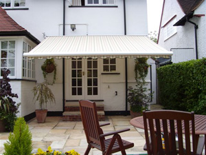 Most awnings are wider than they extend. The Tortola awning uses crossover arms to extend out more than its width