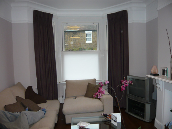 Faux suede curtains on a track with bottom up blinds fitted to UPVC windows