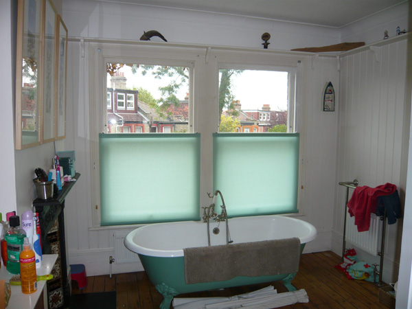 Bottom up blinds in bathroom giving privacy with a light and airy feel
