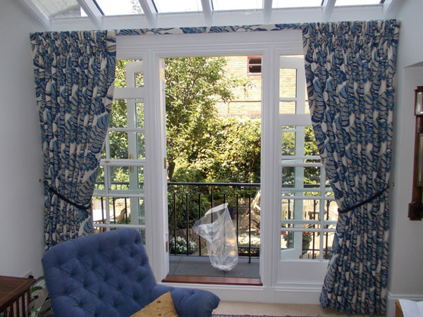 Traditional Sanderson Pinch Pleat curtains, with covered fascia