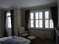 Harlequin interlined on white 50mm wooden poles with plantation shutters Tufnell Park