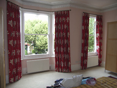 Bay window curtain pole, Romo fabric, pinch pleat, interlined and blackout. Tufnell Park