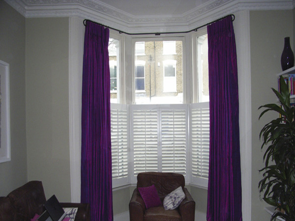 Silk curtains interlined and pinch pleated on bay window pole with ...
