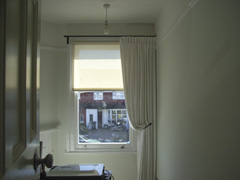 single curtain works well on asymetric window Crouch End