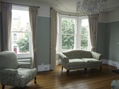 Traditional Sanderson damask interlined and pinch pleated on bay window and straight pole Maida Vale West London
