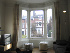 Linen curtains on a Bradley Collection bay window pole, 25mm polished steel Highgate