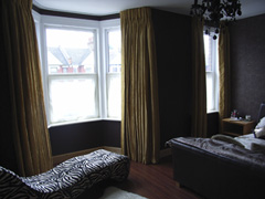Faux silk curtains with a corded white steel curtain track fitted to ceiling Tottenham