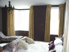 Faux silk curtains with a corded white steel curtain track fitted to ceiling Wood Green