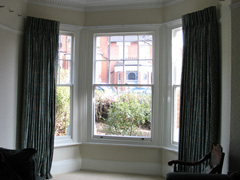 French cloque work in silk, interlined and pinch pleated curtains, corded steel bay window track Hornsey