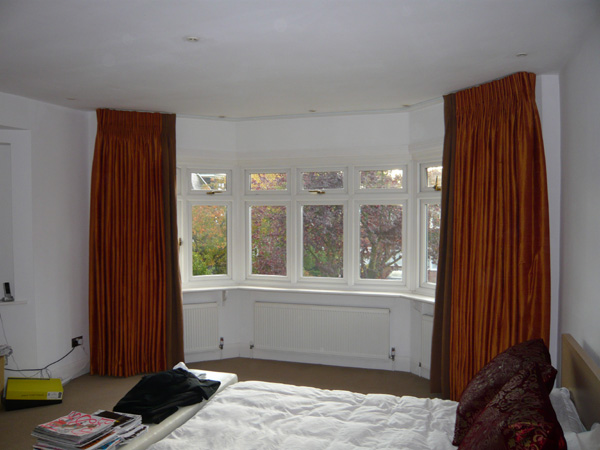 Silk curtains with linen leading edges