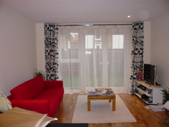 eyeletted curtains on double chrome pole with voiles behind Islington
