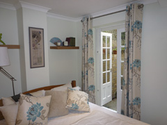 Romo curtains interlined and eyeletted on a pole Tufnell Park