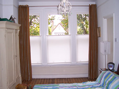 Artificial silk curtains, eyeletted on a pole with bottom up blinds for privacy Crouch End