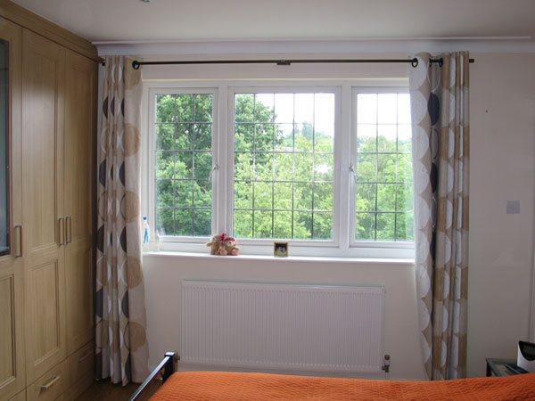 Eyeletted curtains with blackout lining