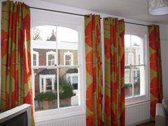 marimekko gingko interlined and eyeletted on poles Stoke Newington