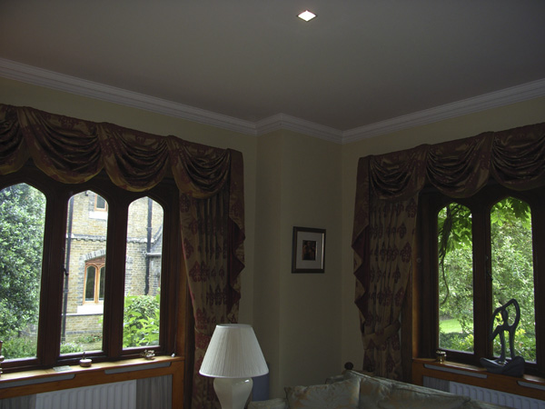 Very traditional swags and tails complement the right window.