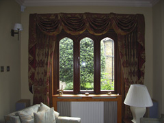 Curtains with swags and tails for a more traditional look Highgate