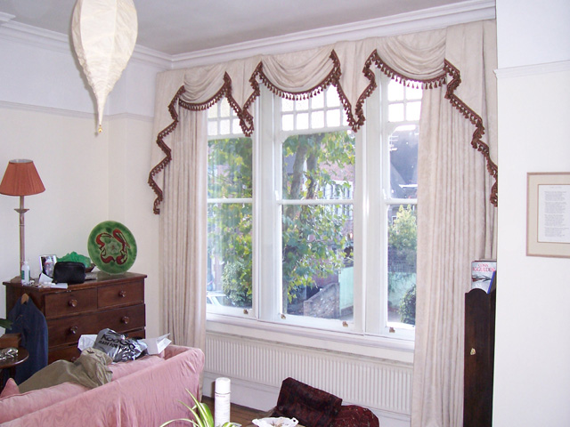 Curtains with swags and tails and jabots ( the bits connecting the swags )