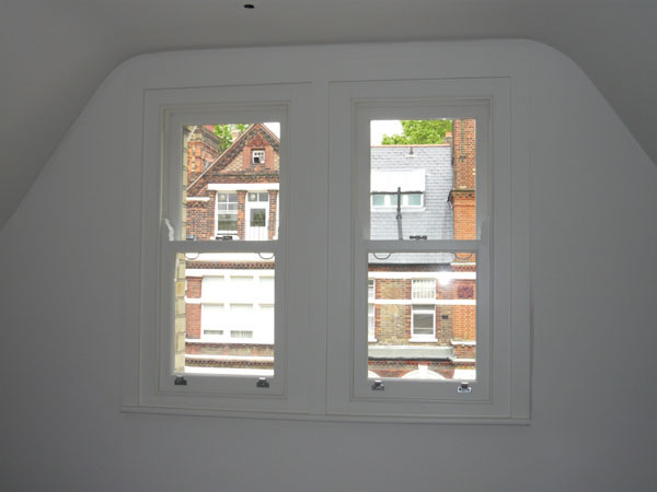 pair of windows - side by side - before blinds are fitted