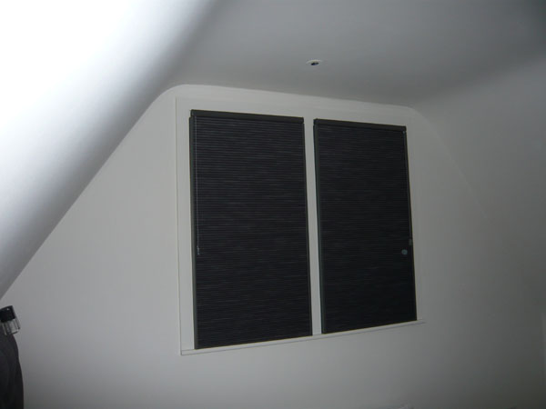 Blackout Duette blinds with side channels - here photographed with flash from where the bed is