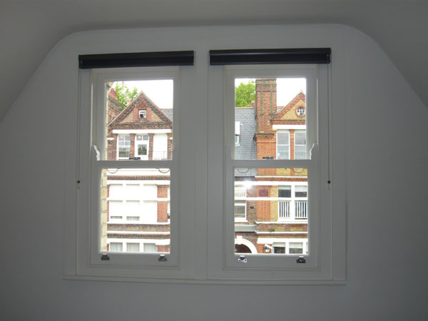 pair of windows with duette blinds fitted and stacked at top