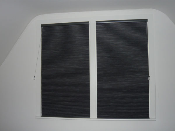 pair of duette blinds fitted to windows and lowered