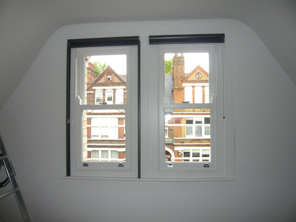 Pair of duette blinds fitted, now one blind has had side channels installed