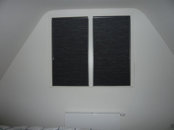 Blackout Duette blinds with side channels - here photographed with flash