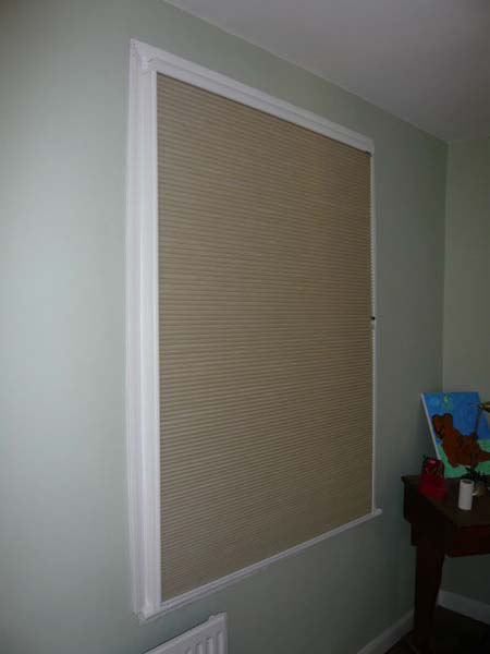 blackout duette blind fully lowered inside side channels