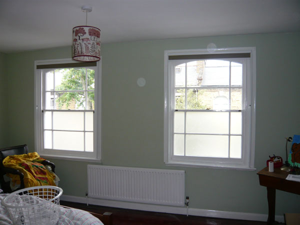 Duette blackout blinds fitted with side channels in this North London bedroom