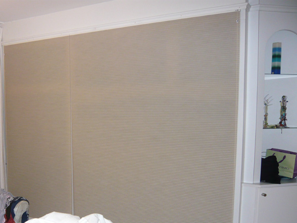 Duette blinds concealing wardrobe and shelves