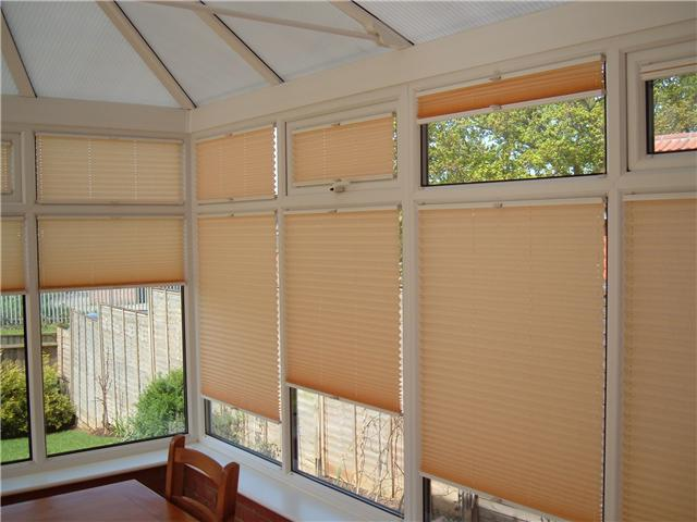 Pleated blinds fitted to each window
