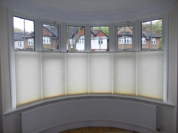 Top down - bottom up Luxaflex duette blinds at a bow window