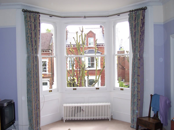 38mm two bend baypole fitted and curtains hung and curtains dressed and tied to set the pleats