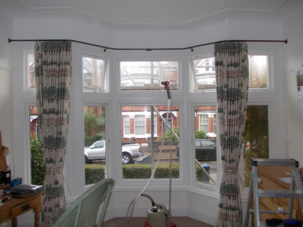 19mm wall to wall reverse bend baypole fitted in London now we dress the pleats and tie the curtains to set the pleats