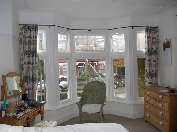 19mm wall to wall reverse bend baypole fitted in London the curtains stack back well