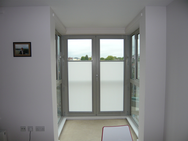 Luxaflex Nano roller blinds fitted to a pair of balcony doors in Central London