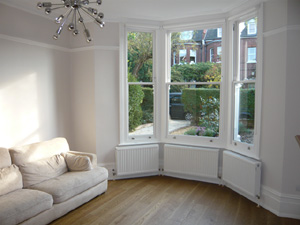 simple white roller blinds installed in Muswell Hill - Finchley