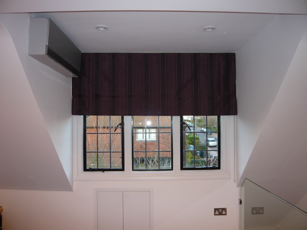 Blackout roman blind with control chain option