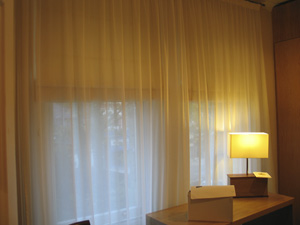 blackout roman blinds with a voile curtain for privacy and to soften the overall effect Highgate