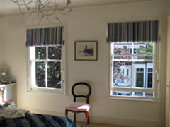 Blackout Roman blinds in a vertically striped fabric Islington