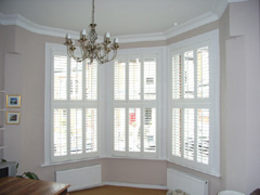 silk white tier on tier shutters with 63mm louvres Highgate