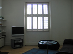 Wood shutters with 47mm louvres, tier on tier Kentish Town