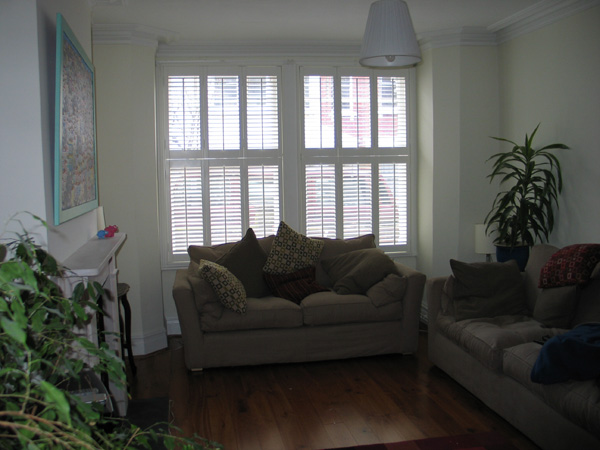silk white shutters LLL and RRR tier on tier with 64mm louvres
