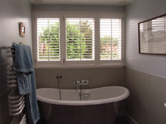 Plantation shutters in bathroom in highgate