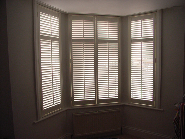 MDF shutters with 63mm louvres in silk white