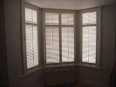 MDF shutters with 63mm louvres in silk white Finsbury Park