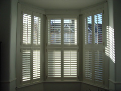 Tier on tier shutters with 63mm louvres Highgate